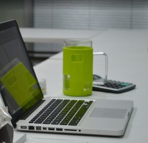 laptop with green mug